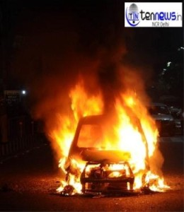 NOIDA SECTOR 14 A CAR CAUGHT FIRE ONE PERSON INJURED