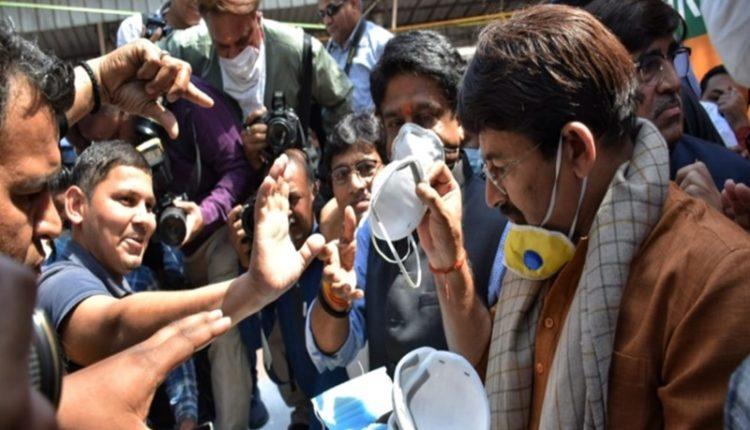 PM encouraged us to distribute masks and sanitizers among all: Manoj Tiwari