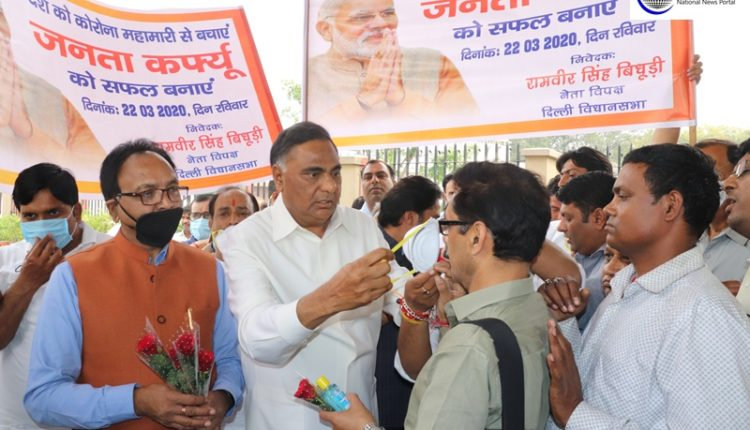 LOP Bidhuri distributes sanitizers, masks and roses in Delhi to aware people of 'Janta Curfew'