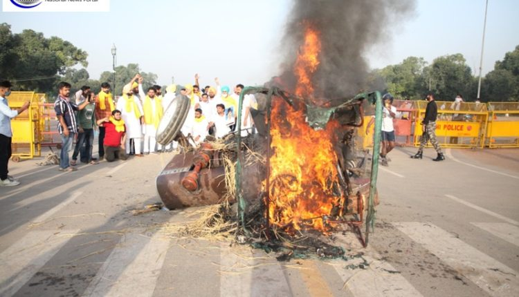 Congress-workers-burn-tractor-while-protesting-against-farm-acts